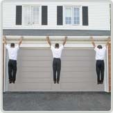 3 men hanging from eavestrough to show strength of product