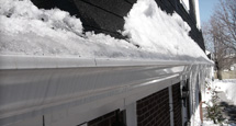 Build up of snow and ice on eavestrough
